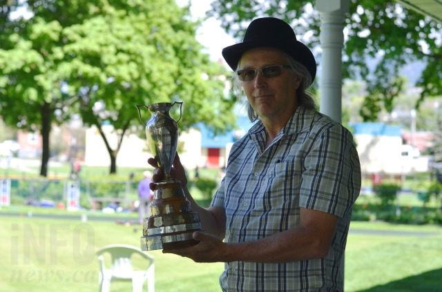 David Nagy holds a lawn bowling trophy from 1929.