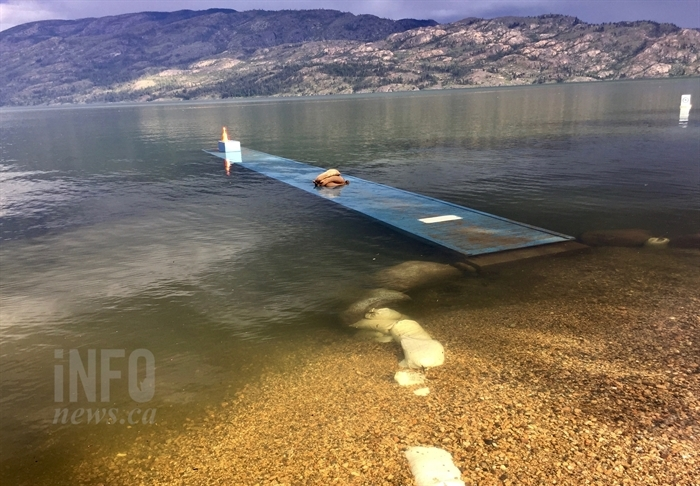 A dock on Okanagan Lake in Peachland is submerged by rising water, Wednesday, May 17, 2017.