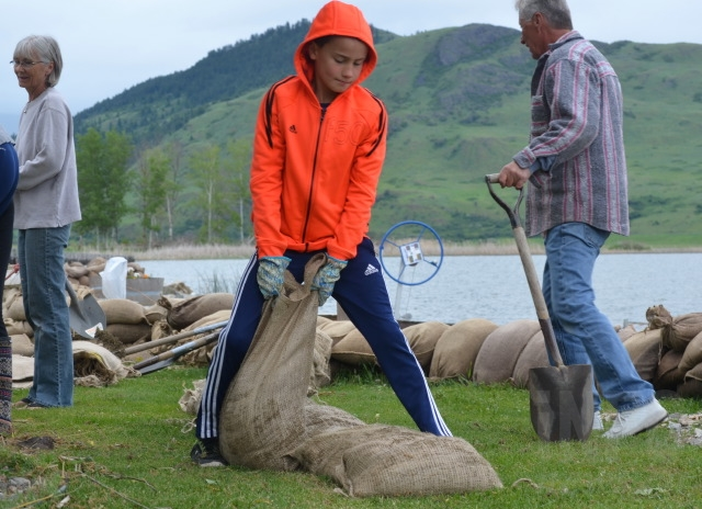 James Tolpinrue, 10, helps sandbag.