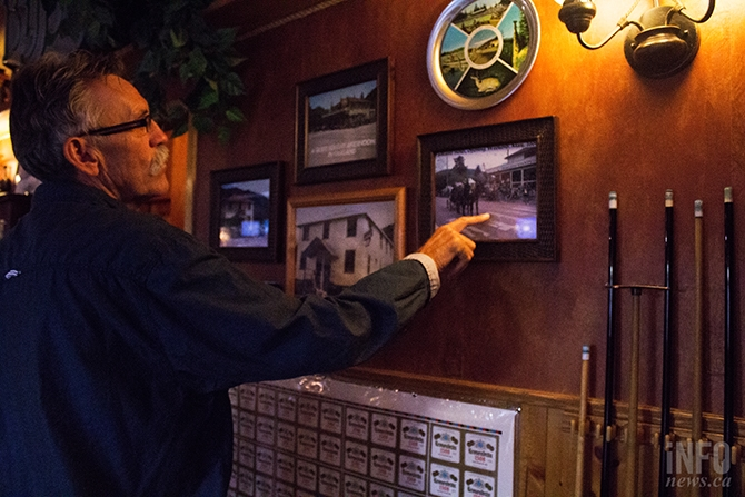 Jeff Kirkham describes the photographs of the pub over the years, all of which are hanging up across from the billiards table.