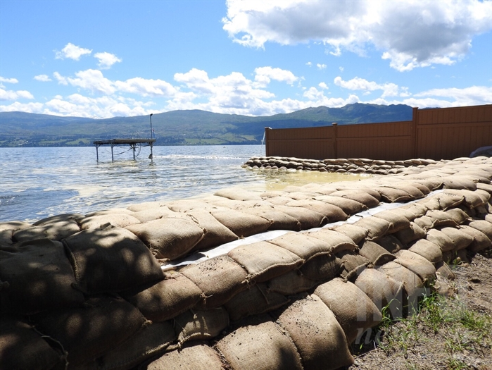 The rising water in Okanagan Lake continues to threaten the  sandbag wall surrounding Green Bay in West Kelowna, Friday, June 2, 2017.
