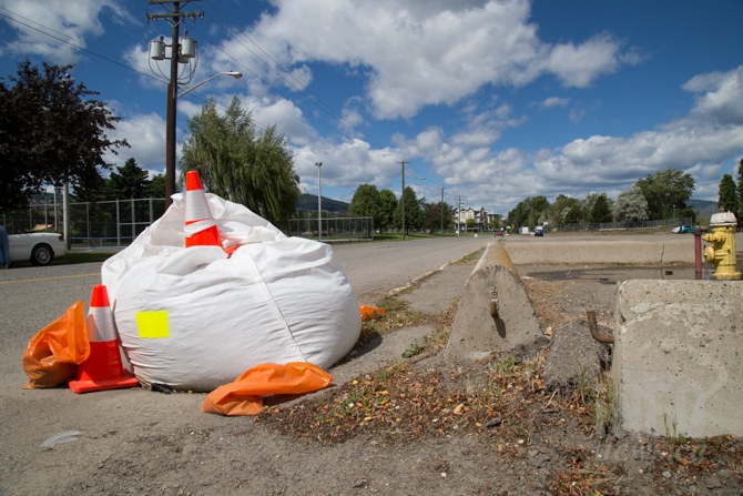 City workers have placed these large bags over storm drains as part of the flood watch procedures.