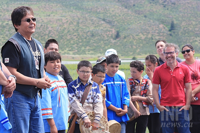 Osoyoos Indian Band Chief Clarence Louis (left)  pays homage to Canadian Formula One racer Jacques Villeneuve (second from right)  at the opening ceremonies of Area 27 east of Osoyoos, June 3, 2017.