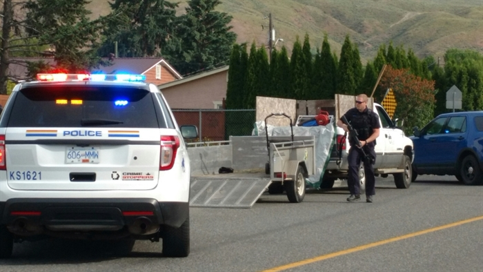 A heavily armed RCMP officer can be seen as police respond to a firearms complaint in the Brocklehurst neighbourhood in Kamloops, Tuesday, June 6, 2017.