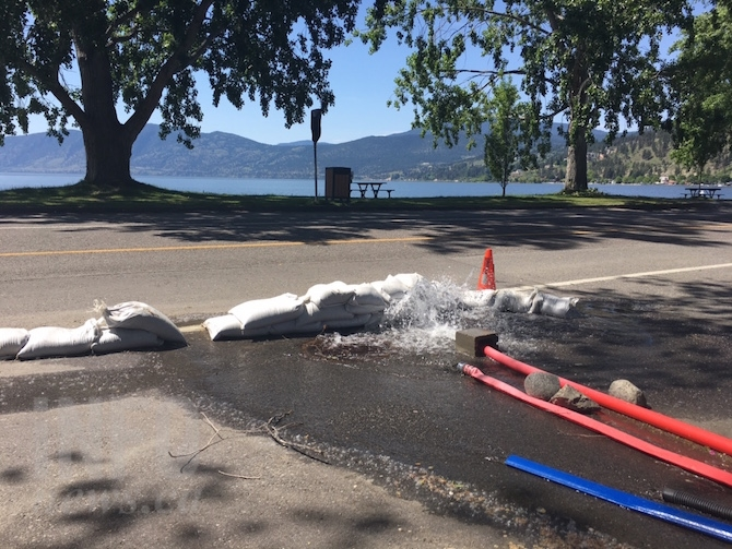 Beach Avenue west of Bliss Bakery in Peachland is closed to accommodate all the hoses pumping the rising ground water out of basements and crawl spaces.