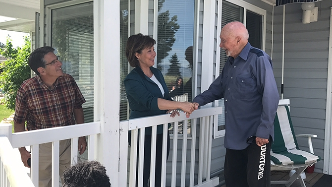 Premier Christy Clark, along with Penticton MLA Dan Ashton, left, visited residents at the Red Wing Resort near Penticton Tuesday, June 6, 2017. Several home are threatened by the rising water in  Okanagan Lake.