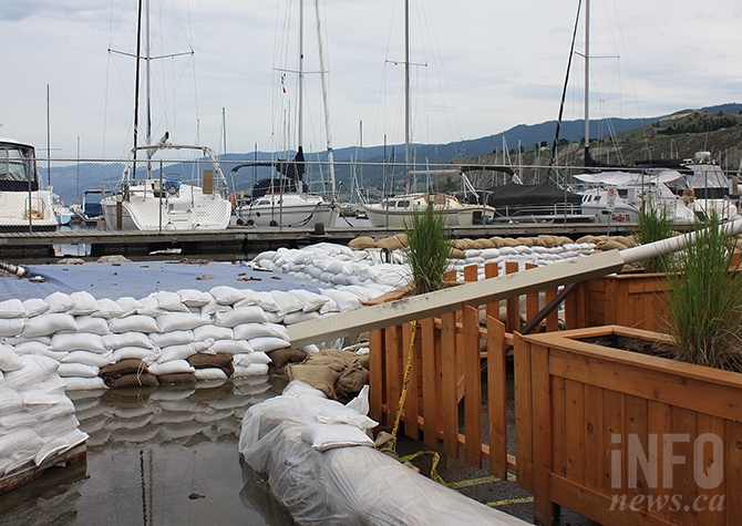 Water continues to seep under the sandbag wall protecting the Penticton Yacht Club's clubhouse from Okanagan Lake.
