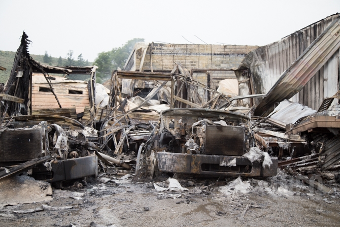 Several delivery trucks were destroyed in the fire.