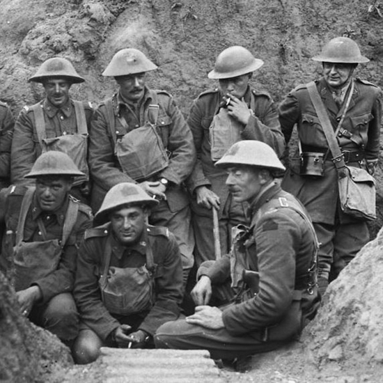Historians believe the man in the top row with his head down and smoking a cigarette may be Frederick Lee. This image is of the 47 Battalion at the Battle of Hill 70.