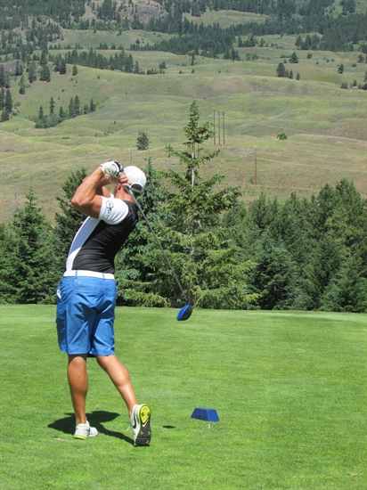 Brian Froese sends his ball down the Fairway during the Cops for Kids Charity Golf Tournament at Black Mountain Golf Club in Kelowna.