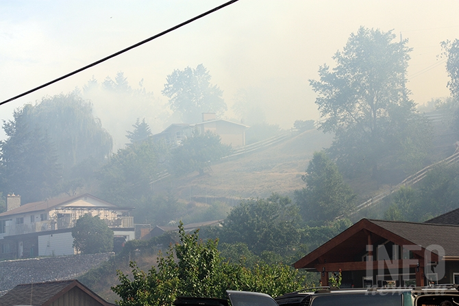 Heavy smoke surrounds homes on Oak Avenue in Kaleden this afternoon.