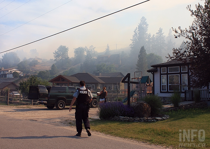 RCMP issue evacuation notices to residents on Ponderosa Drive in Kaleden at the height of yesterday's wildfire.