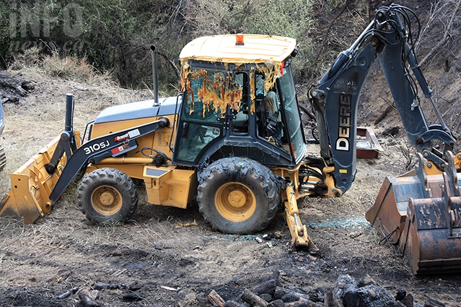 Larry Richardson's loader cab melted from the heat of the wildfire, but he still managed to move the equipment to safety.