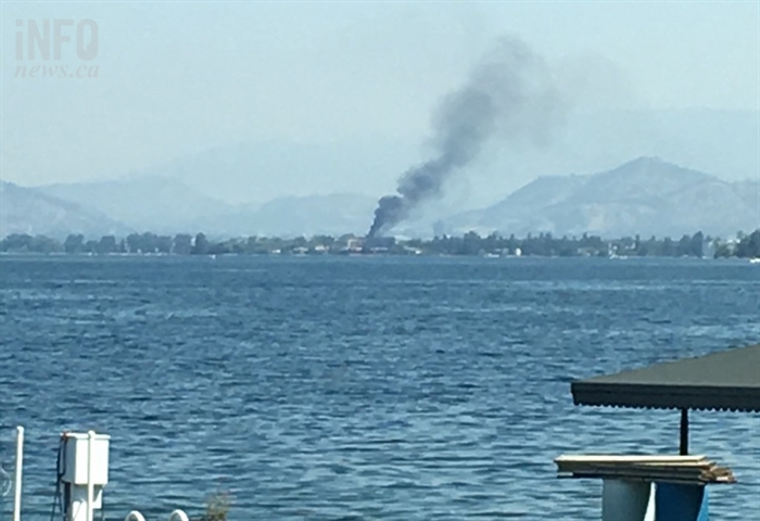 Smoke can be seen from a structure fire in the Lakeshore area July 8, 2017.