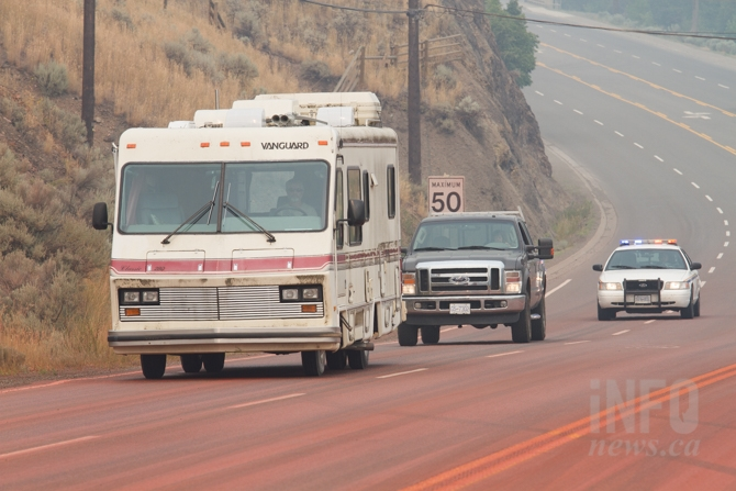 A few vehicles drove through Cache Creek with police escorts close behind.