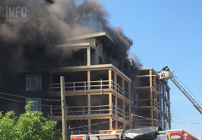 Kelowna firefighters had to rescue four of their own members who became trapped on the balcony of a condo building that caught fire July 8, 2017.