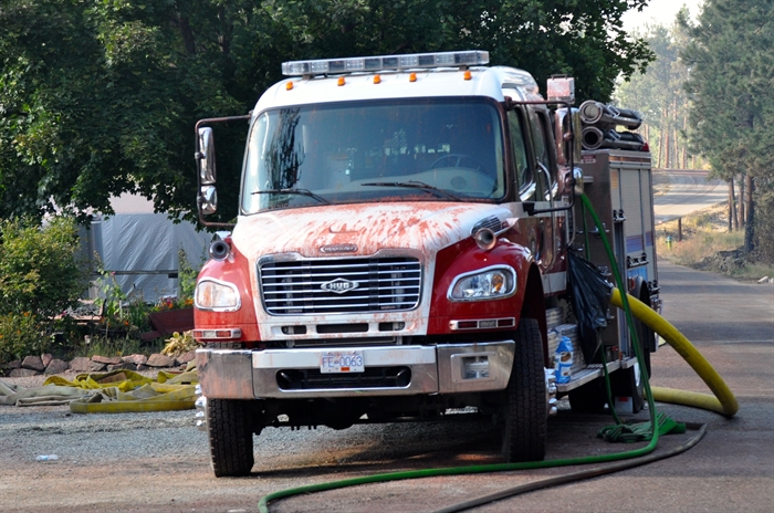 A fire truck is covered with fire retardant.