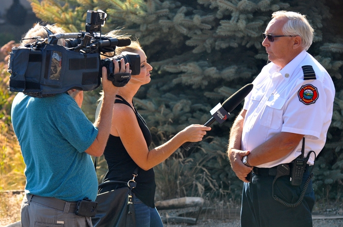 Lake Country fire chief Steve Windsor talks to the media.