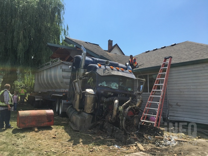 The semi that crashed into the house in Armstrong was pulling a trailer.