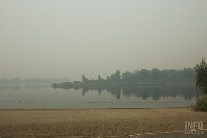 Across the river from Riverside Park, you might mistake the smoke from nearby wildfires for a thick fog.