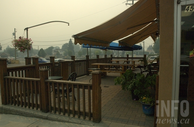 The patio at Jamaican Kitchen is also empty as customer huddle inside to avoid the smoke.