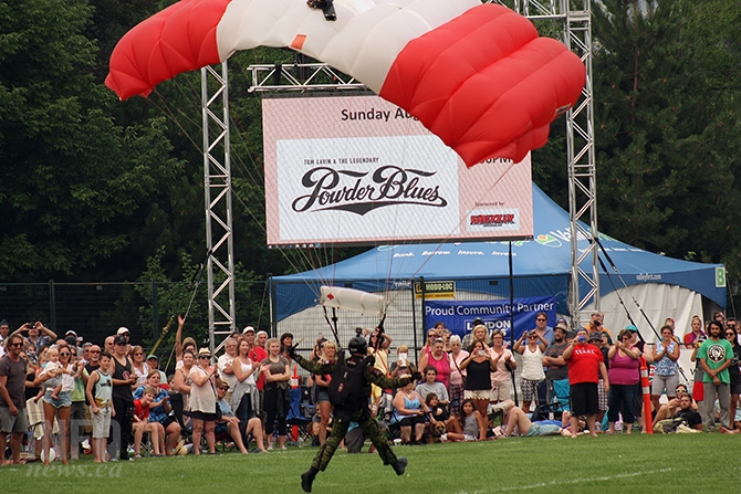 A Skyhawks member runs to a safe landing at Okangan Lake Park on the first day of Peachfest activities, Aug. 9, 2017.
