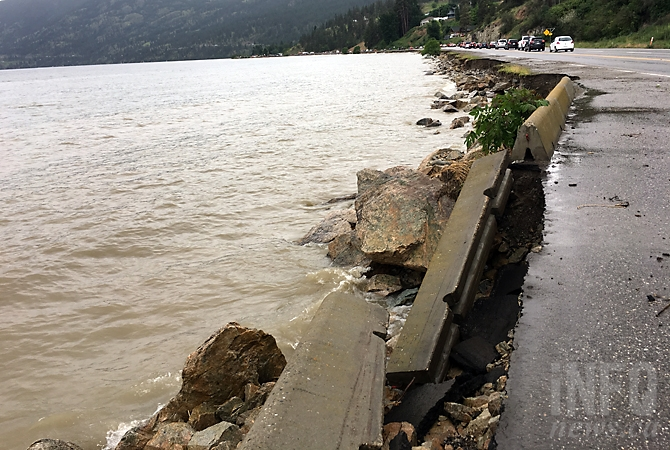 FILE PHOTO: A portion of Highway 97 near Peachland was almost closed during a windstorm in June that toppled concrete barricades.