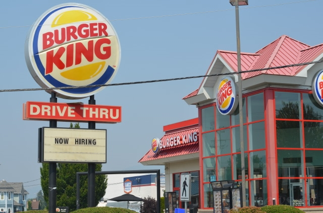 A 'now hiring' sign seen at the Vernon Burger King on July 31, 2017.