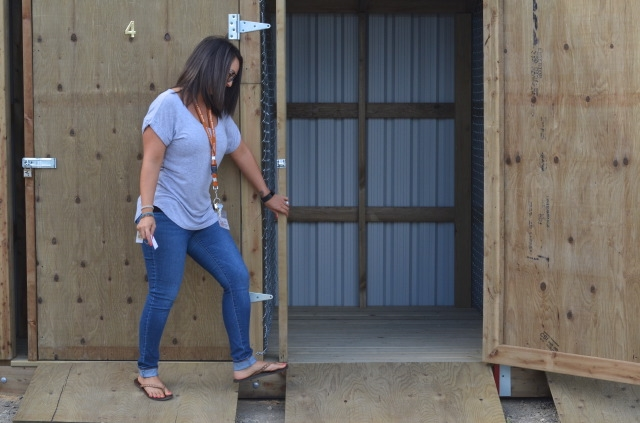 Lisa Anderson, co-executive director of the Upper Room Mission, opens up a storage shed.