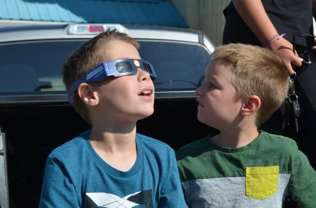 Nathan Anderson, 9, watches in awe as the moon passes in front of the sun.