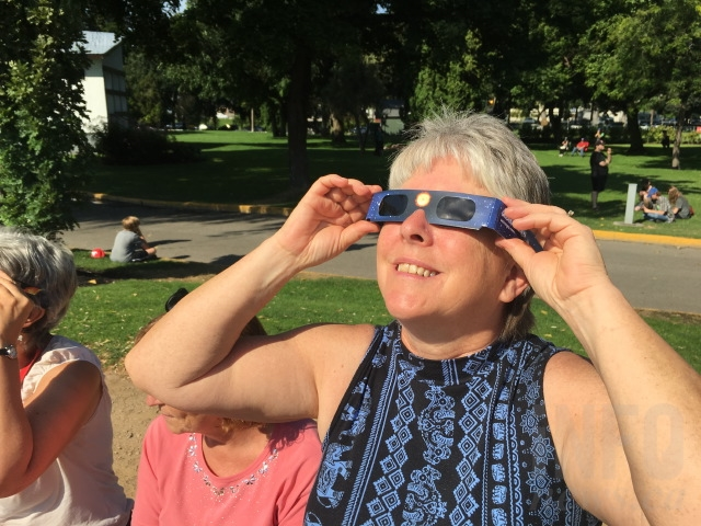 Science teacher Annette Toop gazes up at the eclipse.