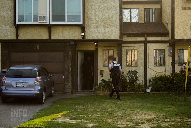RCMP officers at a home on Cambridge Crescent in Kamloops where a potential incendiary device was found, Tuesday, Aug. 29, 2017.