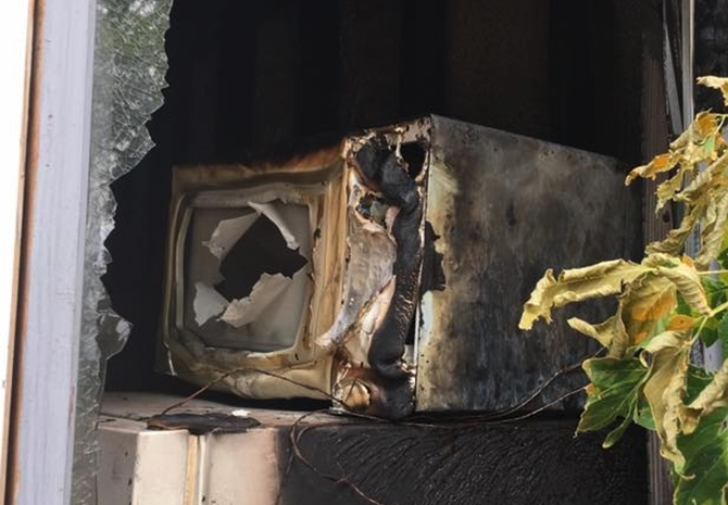 The couple's home nearly burned down when someone broke into the home and started the microwave with metal inside.