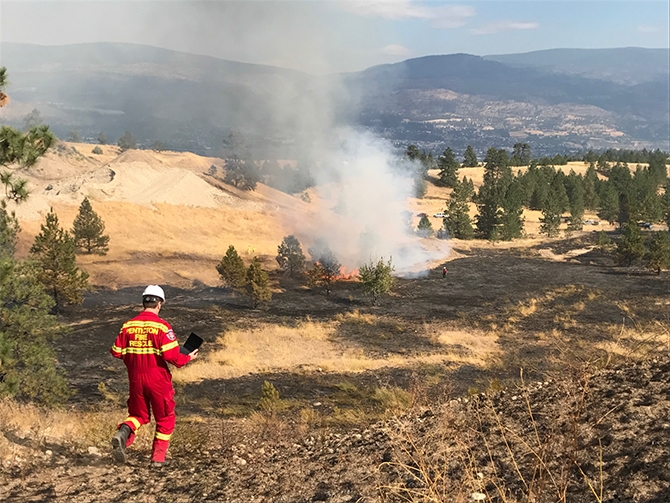 Penticton Indian Band, city and B.C. Wildfire crews are fighting a grass fire near the Westhills Aggregates gravel pit on West Bench, Friday, Sept. 1, 2017.