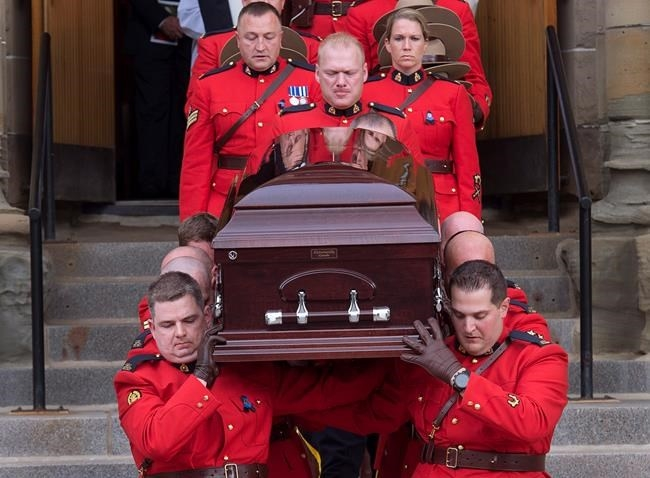 Pallbearers carry the coffin at the regimental funeral for RCMP Const. Francis Deschenes at St. Bernard's Catholic Church in Moncton, N.B. on Wednesday, Sept. 20, 2017. Deschenes was killed after he stopped to help a motorist change a tire and a cargo van slammed into his cruiser.
