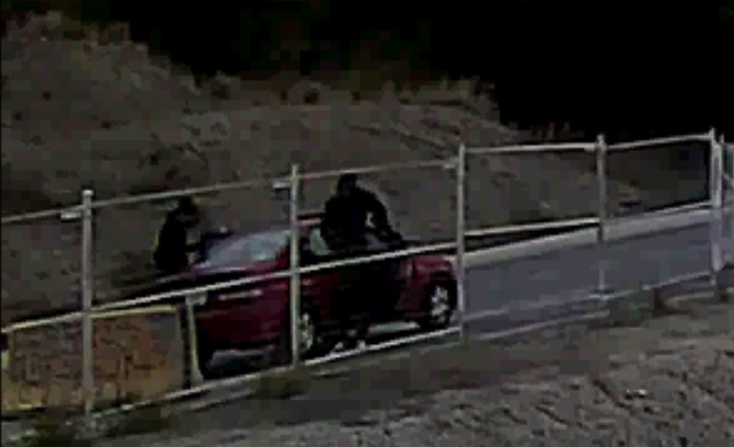 Surveillance footage shows the two suspects entering the vehicle on Sept. 21.