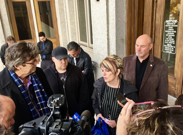 Jason's father John Hardy and step-mom Connie Allard speak to reporters Oct. 23, 2017.