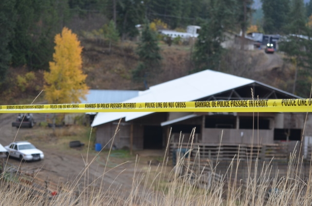 The large rural property at 2290 Salmon River Rd. is wrapped in police tape, Wednesday, Oct. 25, 2017.