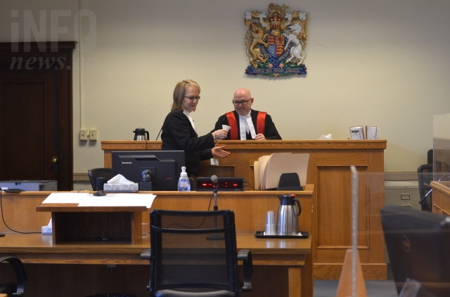 Judge Richard Hewson in court with provincial family court clerk Giselle Wood.