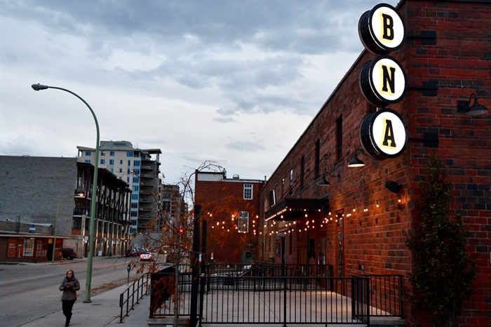 A pedestrian walks by BNA Brew pub and restaurant in downtown Kelowna.