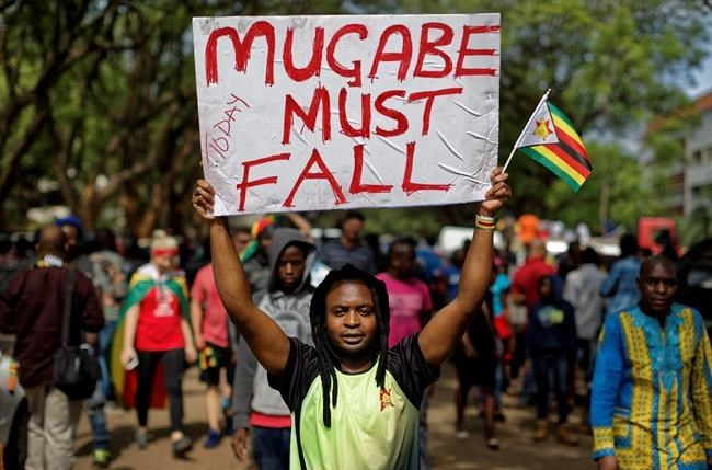 Protesters demanding President Robert Mugabe stands down march towards State House in Harare, Zimbabwe Saturday, Nov. 18, 2017.
