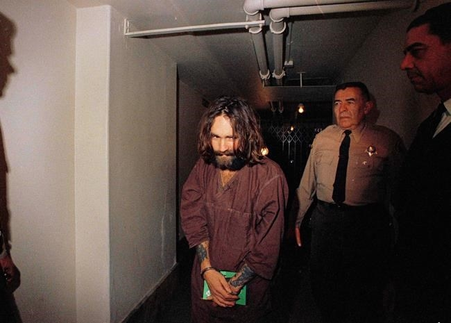 FILE PHOTO - In this 1969 file photo, Charles Manson is escorted to court in Los Angeles during an arraignment phase.