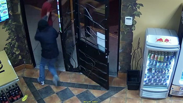 Video surveillance footage shows an armed robbery suspect chasing as employee out of Toro's Cold Beer and Wine store on Kalamalka Lake Road in Vernon, Friday, Nov. 24, 2017.