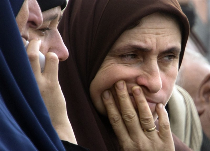 Relatives of injured worshippers grieve outside Suez Canal University hospital in Ismailia, Egypt, Saturday, Nov. 25, 2017, a day after an attack on a mosque.