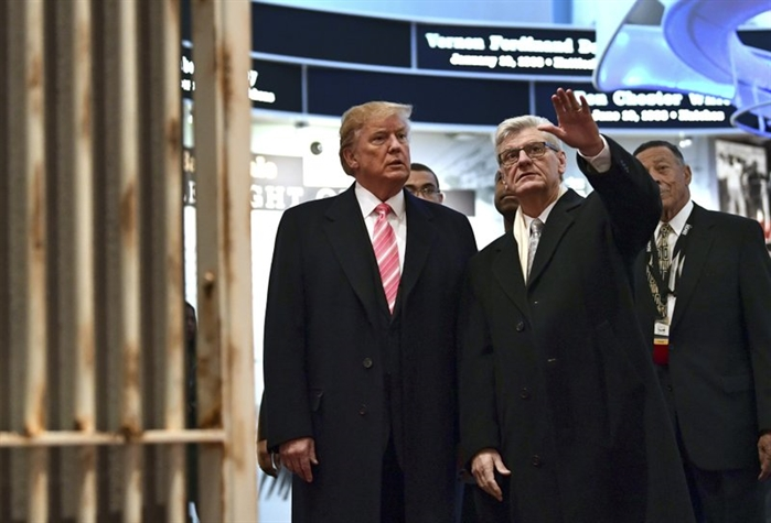 Trump, left, listens as Mississippi Gov. Phil Bryant, right, shows him the Hinds County Jail on display at the newly-opened Mississippi Civil Rights Museum in Jackson, Miss., Saturday, Dec. 9, 2017.