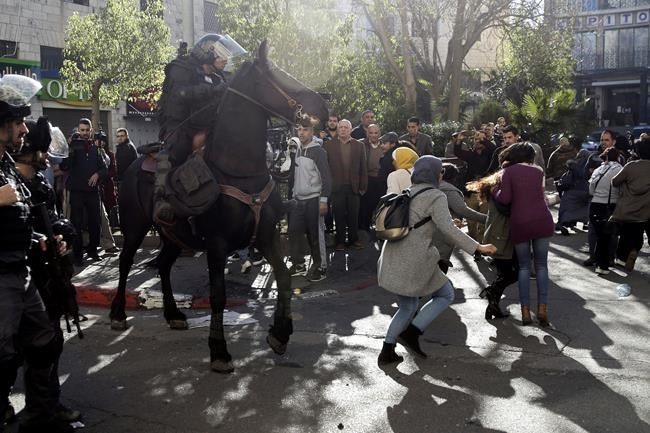 Israeli horse mounted police charges Palestinians during a protest against U.S. President Donald Trump's decision to recognize Jerusalem as the capital of Israel in Jerusalem, Saturday, Dec.9, 2017.