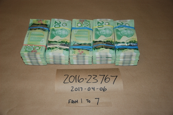 Cash RCMP say was seized from Brandon Chappell's home in Kamloops.