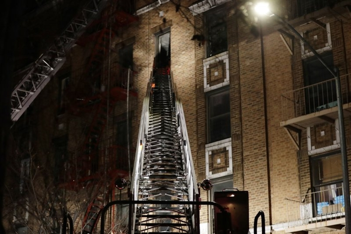 Firefighters respond to a deadly fire Thursday, Dec. 28, 2017, in the Bronx borough of New York.