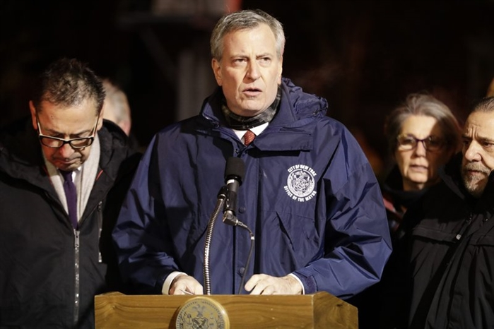 New York City mayor Bill de Blasio speaks during a news conference after fire crews responded to a building fire Thursday, Dec. 28, 2017, in the Bronx borough of New York.