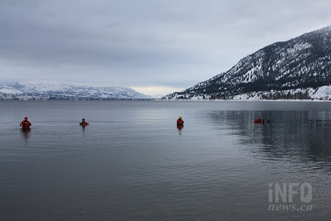 Members of Penticton Search and Rescue wait patiently for the stroke of noon at Sun-Oka Beach today, Jan. 1, 2018.